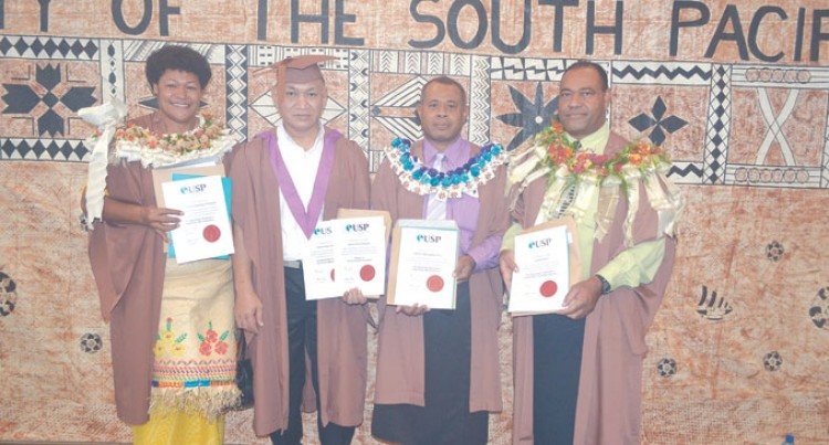 Four Officers Graduate