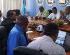 Former Officials Pass Baton