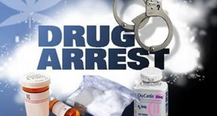 Officer Held in Drug Bust