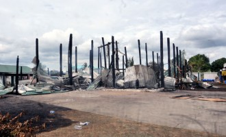 Businessman Counts Losses After Home Fire