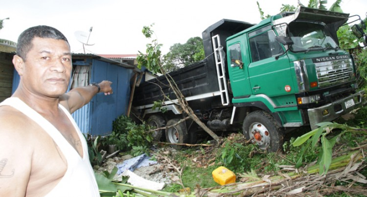 Trucks Rolls, Damages House, Family Unhurt