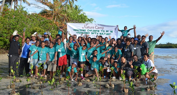 children replant mangrove as part of nature conservation education