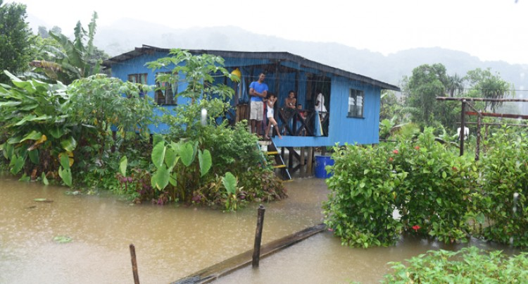 Siblings alone in house in flooded  settlement