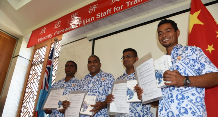China Stint For Four  Fijian Road Workers