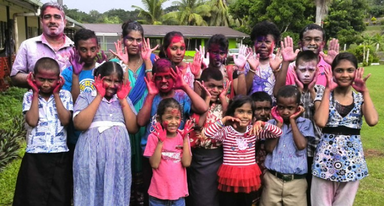 Students Celebrate Holi, Easter in Unity