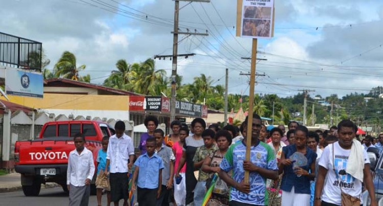 Holy Family Parish Mark Good Friday With March Through Street
