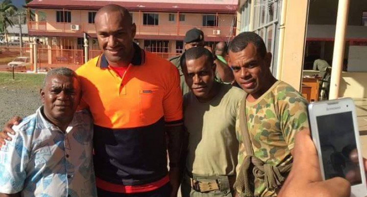 Star Winger Visits Cyclone Victims