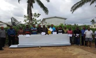Former Resident Donates Housing Materials