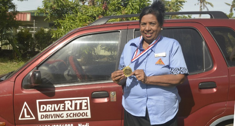 Dorothy Samuel Receives Award For Achievement As Driving Instructor