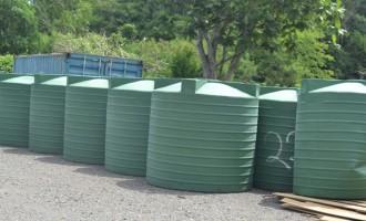 Tanks Ease Settlement Resident Woes