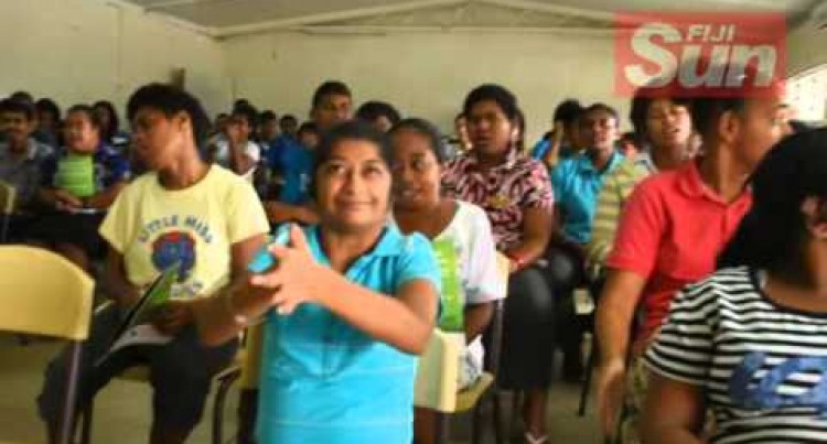 Fiji Vocational & Technical Training Centre for Persons with Disability (FVTTCPD)  students singing at the Handover Of items
