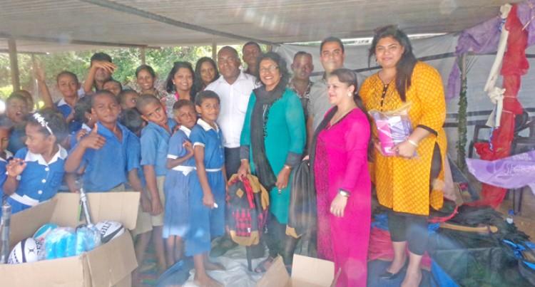 Teachers From NZ Donate to School