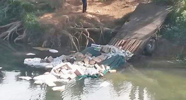 Truck Plunges Into River