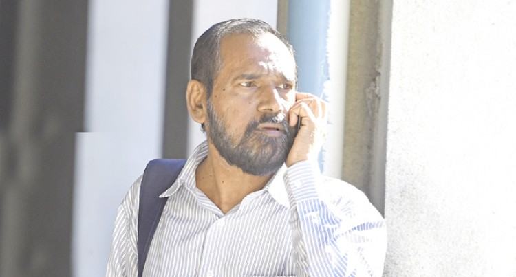Hussein In Court With Forgery Charges