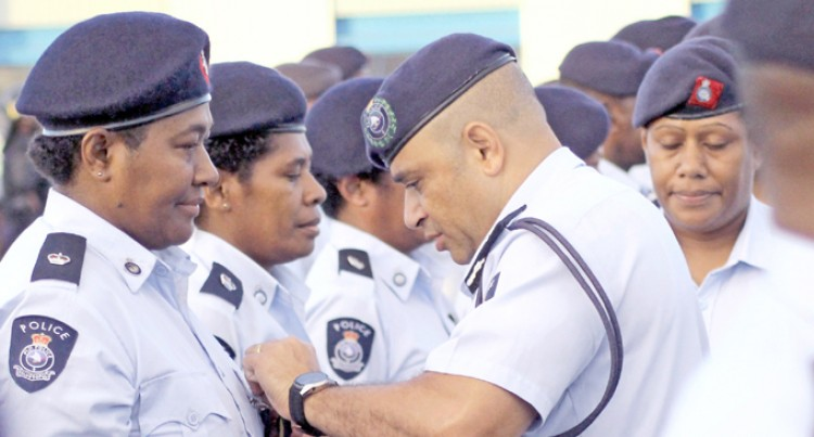Senior Police Officers Receive Medals