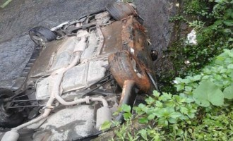 Driver Ok After Car Plunges In Drain