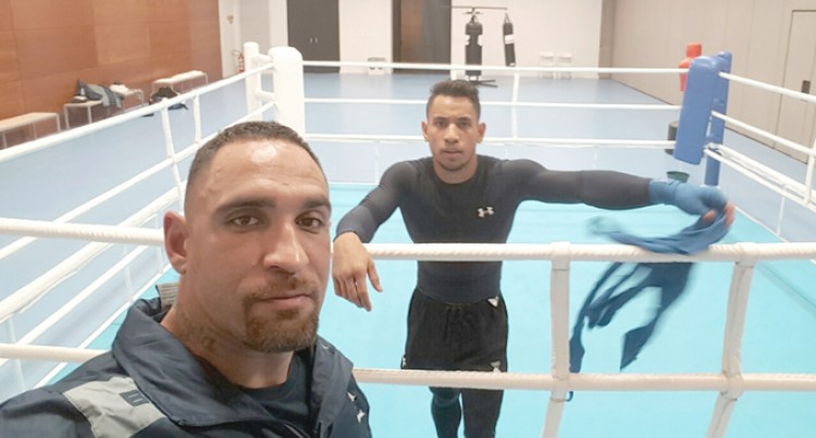 Boxing Coach Remains Positive