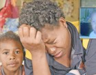 Family Mourns Death Of Girl, 2