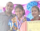High Scorer Acknowledges Parents' Support