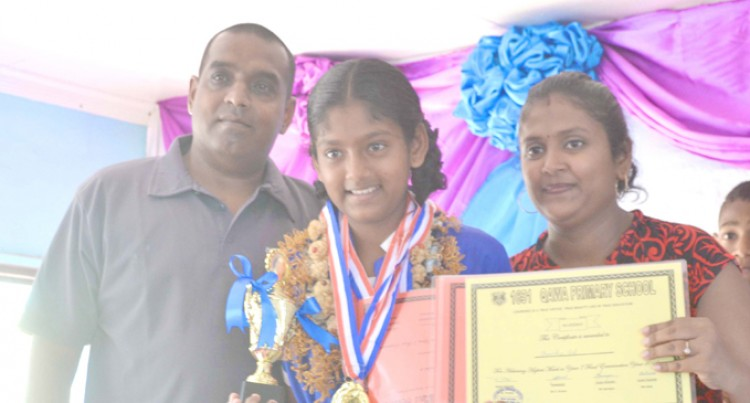 High Scorer Acknowledges Parents' Support