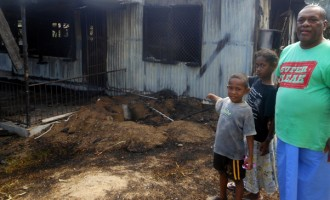 Family Flee To Safety From Burning House