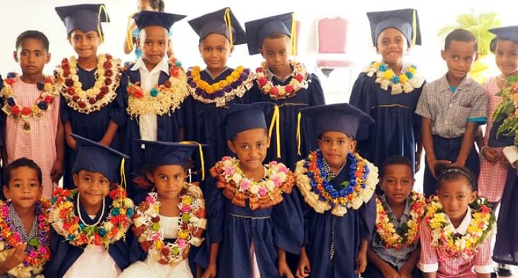 Teacher, 70, Proud Of Young Graduates