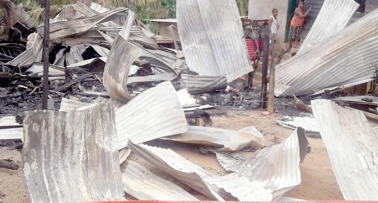 Fire Destroys Four Families' Home