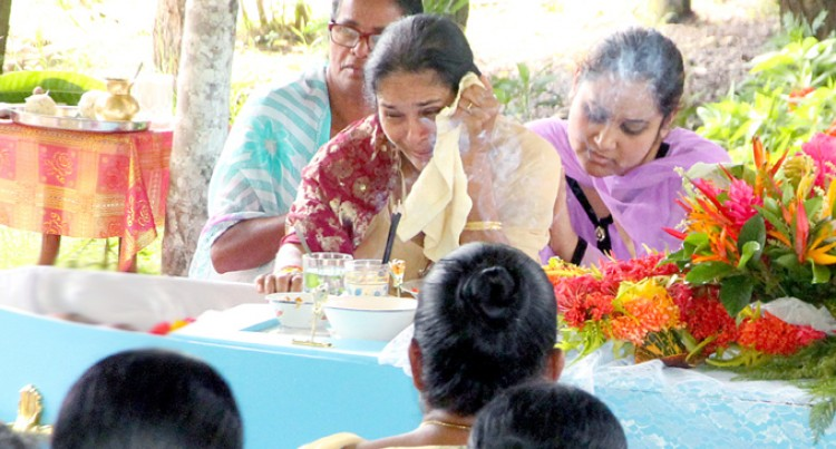 Widow's Cry Fills Air At Funeral Gathering