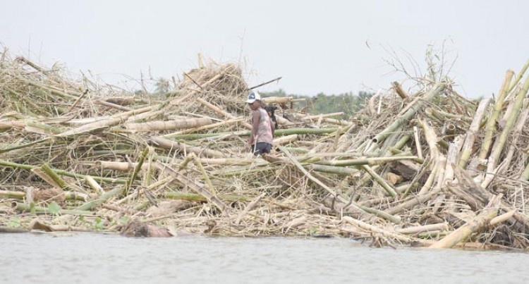Debris Blocks River, Travel Now Harder for Villagers