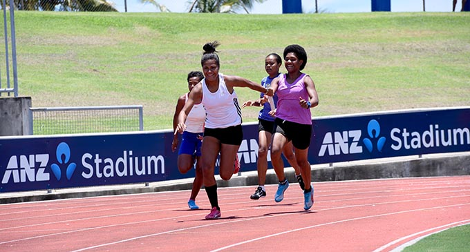 Una Ratulevu receives the baton from Olivia Tanivanuakula in the girls Open grade 4X100 metres relay at the ANZ Stadium in Suva yesterday. Photo: Jone Luvenitoga