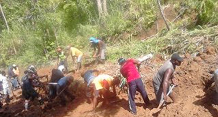 Villagers Clear Away Landslides With Hands, Tools