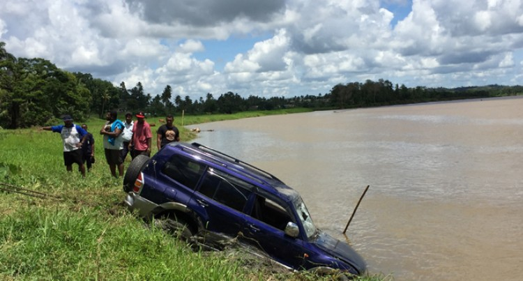 Driver Escapes Injuries in Early Morning Plunge