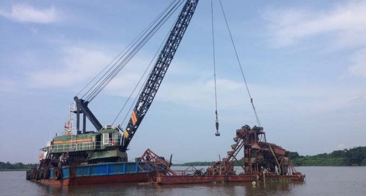 Boat Operators Relieved Submerged Dredge Salvaged