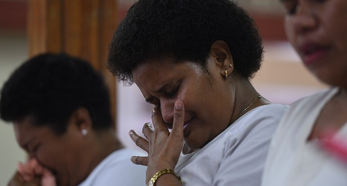 Tears flow as Koro islanders remember  villagers killed during Cyclone Winston