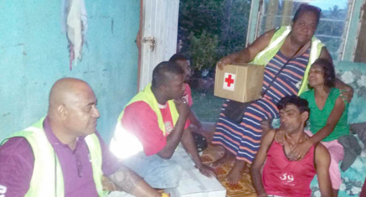 Red Cross Delivers Relief For Family In Mourning