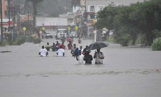 Truck carries students through flooded roads