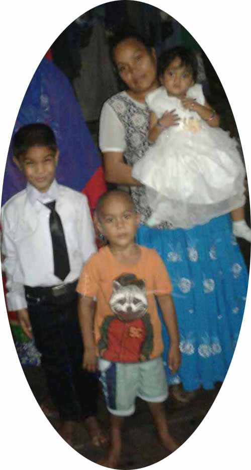 IN HAPPIER TIMES... Three of the children who are dead Mohammed Ayaan, 6 (left), Mohammed Arman, 4 (middle), and Ahana Khaiyum, 1 (being carried). They are pictured here with their mother and grandmother.