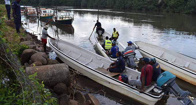 Police officers used three fibre glass boats in search for the two missing siblings, a four-year-old and a one-year-old, and their father in the Labasa River yesterday. Photo: Shratika Naidu