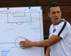 Football National Coach Works Against Time