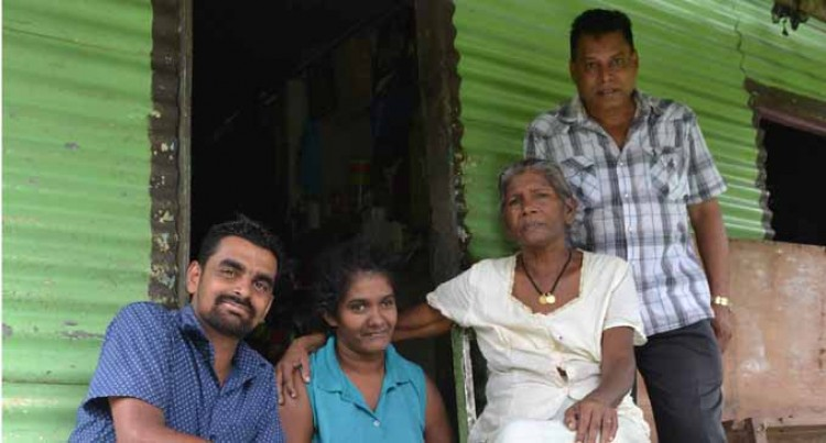 Rotary Club helps repair widow's house