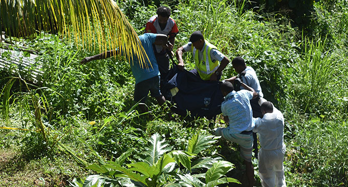 Police carry Seremaia Vana's body from the creek at Kaunitoni Street in Lautoka. Photo: Charles Chambers