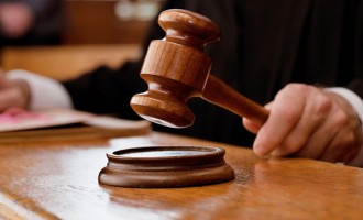 Woman Fronts Court  On Robbery Charges
