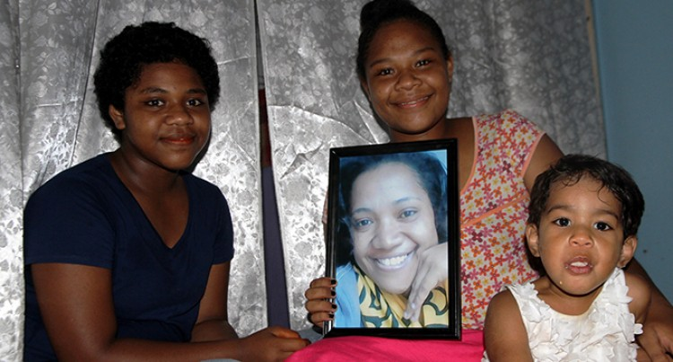 Daughter of Cancer Victim Vows to  Look after Siblings
