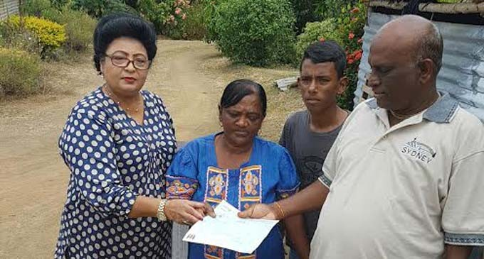 Bhatnagar Hands Cheques For West Families