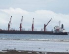 Clinker Discharged To Trucks On Barge