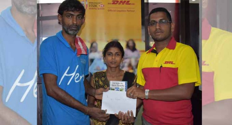 DHL Staff Assist Family in Labasa