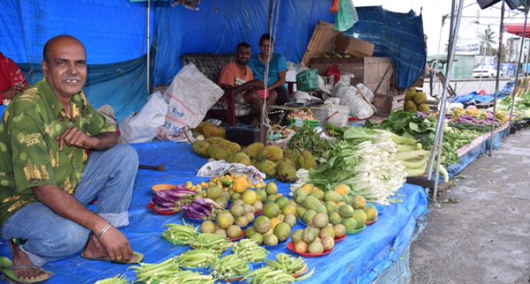 Market Vendor Gets Support From Wife