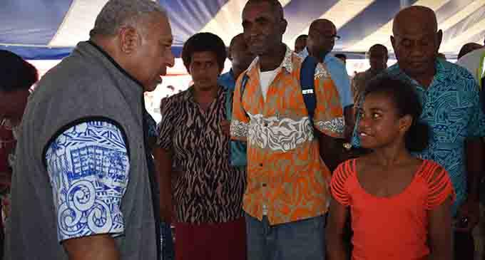 Prime Minister Voreqe Bainimarama chats with 11-year-old Brunelle Reapi in Rakiraki on May 8, 2017. Photo: Charles Chambers