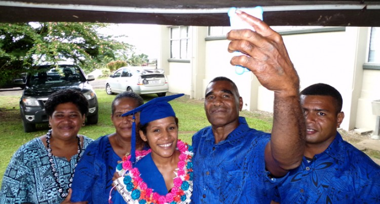 Graduate Credits Family's Support