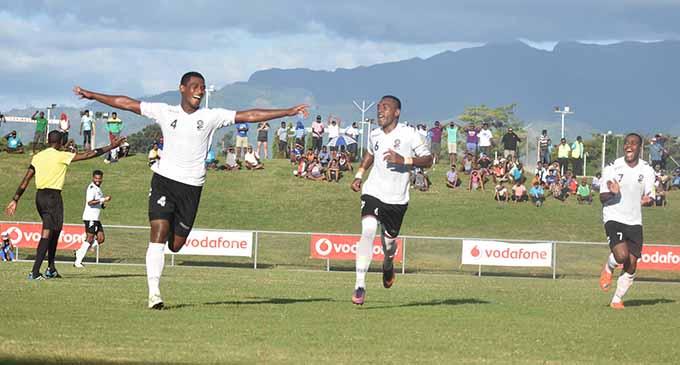 Vodafone Fiji Kolinio Sivoki celebrates his goal against Solomon Islands at the Churchill Park in Lautoka yesterday. Photo: WAISEA NASOKIA